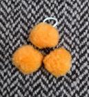 Gumička do hřívy s bambulkami - oranžová
